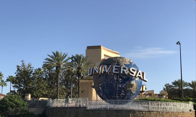 Is it better to stay on-site or off-site when visiting the parks in Orlando?